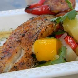 Paprika-Spiced Grilled Cod and Party-in-Your-Mouth Mango Salsa! Recipe - Fresh mango salsa over paprika-spiced cod served in a warm flour tortilla makes a terrific meal on a hot summer night.