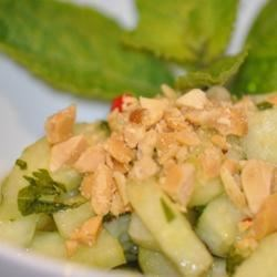 Thai-style Cucumber Salad Recipe - Crisp cucumber is quickly marinated in tamarind juice, ginger, fish sauce, sesame oil, and red pepper flakes in this fragrant side dish.