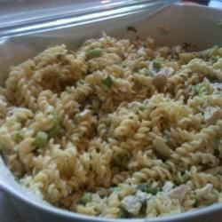 Rotini Chicken Salad Recipe - Rotini pasta, chicken breast, Parmesan cheese, and fresh parsley are the main components of this hearty salad.
