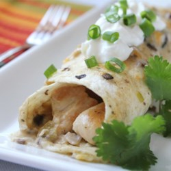 Chicken Enchiladas II Recipe and Video - No tomatoes in this recipe for chicken enchiladas, just a satisfying cheese and chicken filling with a creamy sauce over all. Kids love these and it's a great way to use leftover chicken.