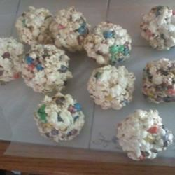 Popcorn Candy Balls Recipe - This is similar to making crispy rice squares but using popcorn instead.