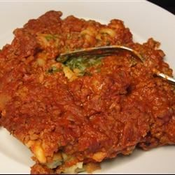 Inside Out Ravioli I Recipe - All the tasty ingredients that you find inside ravioli are used in this hearty pasta casserole. Layer a meaty tomato sauce with a tasty blend of spinach, pasta, bread crumbs, shredded cheese and eggs, then let your oven take over from there.