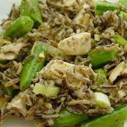 Chicken and Snap Pea Wild Rice Salad Recipe - A safflower-tarragon vinaigrette and toasted almonds flavor this filling salad.