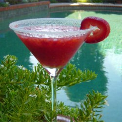 Strawberry Daiquiri II Recipe - A surprise ingredient brings out the flavor of the strawberries in this cool, refreshing cocktail.