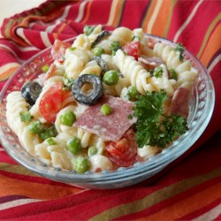 American-Italian Pasta Salad Recipe - Garden veggies with fusilli pasta, Italian Parsley, Genoa salami and creamy Italian dressing makes for a pasta salad that will be a favorite at your next picnic or potluck.