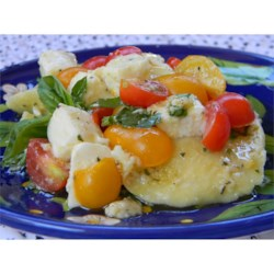 Ravioli with Cherry Tomatoes and Cheese Recipe - You can use cheese or meat ravioli in this recipe. Sausage ravioli are particularly good!