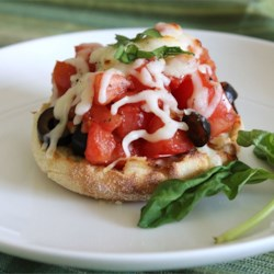 Best Ever Bruschetta! Recipe - Toasted English muffins topped with tomato, olives, and mozzarella cheese.