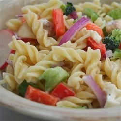 Eat Your Veggies Pasta Salad Recipe - This pasta salad features a kaleidoscope of crunchy veggies. Combine pasta with broccoli, cauliflower, carrots, celery, bell peppers, mushrooms and fiery sweet red onions, and dress with sweetened mayonnaise and vinegar.
