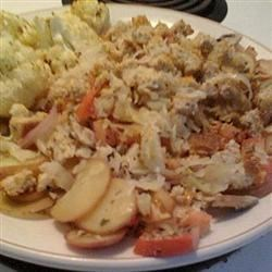 Mediterranean Casserole Recipe - This Italian-influenced casserole features canned sardines with potatoes, cherry tomatoes, and garlic.