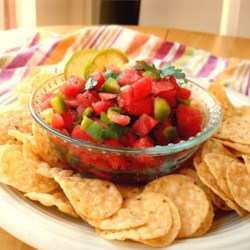 Watermelon Fire and Ice Salsa Recipe - Juicy watermelon replaces tomatoes in this salsa that's simultaneously cool and spicy hot -- perfect for a summer barbeque. Serve it with tortilla chips, or use it as a topping for grilled chicken or fish.