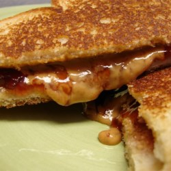Grilled Peanut Butter and Jelly Sandwich Recipe - This is peanut butter and jelly with a twist. The kids will thank you for them.
