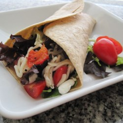 Baby Greens and Goat Cheese Wrap Recipe - Roll up a whole wheat tortilla filled with a flavorful mix of salad greens, sprinkle with goat cheese and roasted red peppers, drizzle with oil and vinegar, and lunch is ready.