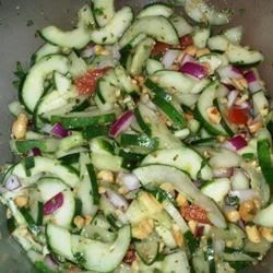Asian Cucumber Thai Salad Recipe - A sweet and tangy cold cucumber salad has Thai-inspired flavors of cilantro, fresh mint, and peanuts.