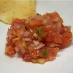 Restaurant Style Salsa Recipe - In only 10 minutes you can whip up a Mexican restaurant-style salsa to enjoy with tortilla chips or add zip to your dinner. Canned tomatoes and peppers are blended with onions, garlic, lime, and cilantro.