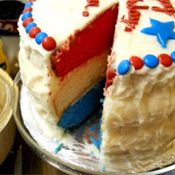 Surprise Inside Independence Cake Recipe - This three-layer cake has a star-spangled surprise inside when you cut and serve it: red, white, and blue layers divided by thick white frosting. They'll ooh and aah when they see it.