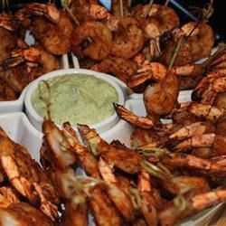 Spicy Chipotle Grilled Shrimp Recipe - Marinated shrimp, grilled on skewers, have the fiery flavors of chipotle chilies, garlic, and red pepper flakes. This is for those who like their grilled shrimp spicy enough to break a sweat.