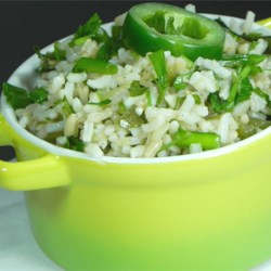 Green Rice III Recipe - Rice is simmered in chicken broth with jalapenos, green onions, and sherry, then tossed with cilantro and parsley for a spicy and unique side dish.
