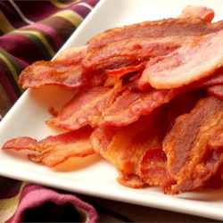 Bacon for the Family or a Crowd Recipe - This is the way to get crisp bacon without having to constantly turn it, watch over it, or get burnt by splatters of grease. It 'fries' up flat and doesn't curl, which looks great beside a breakfast plate of eggs, and makes BLT sandwiches much easier. Very nice when feeding a family or crowd.