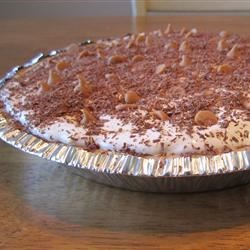 Peanut Butter Pie III Recipe - Chunky peanut butter and confectioners ' sugar are combined, and half is spooned into a baked pie shell. Butterscotch pudding is layered over this and a dreamy whipped concoction goes on top of that. The rest of the chunky peanut butter crumble is then spooned on, and the pie is chilled until ready to serve.