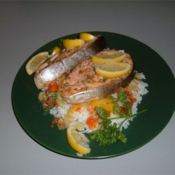 Salmon Steaks Over bed of rice with spicy friut salsa