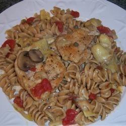 Chicken with Artichoke, Mushrooms, Tomato Over Whole Wheat Pasta