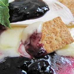 Blueberry Brie Recipe - Warm Blueberry Brie...we have this every year at our work's Christmas party. It is so tasty, it's addictive! You can also make this with raspberry sauce or sun dried tomatoes, both of which taste excellent. This will cook in the microwave in about 3 minutes. Serve with warm French baguette slices!
