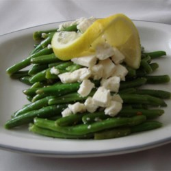 Snow on the Mountain Green Beans Recipe - This is a side dish of fresh green beans cooked in olive oil and lemon juice and topped with feta cheese.