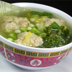 Chinese Lion's Head Soup Recipe - Cabbage is simmered with home made pork meatballs in a light chicken broth. This is my family's version of lion's head soup and for me it is the best type of comfort food! It is best served with white sticky rice, and wonderful enjoyed on a cold winter day.
