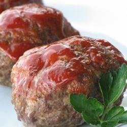 Little Meat Loaves Recipe - These individual meat loaves are topped with a sweet and tangy sauce. The sausage in this recipe yields a more complex flavor than your standard meat loaf.