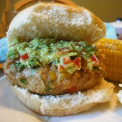Green Chili Chicken Burgers Recipe - Guacamole and salsa give a Southwestern flair to flavorful grilled chicken burgers.