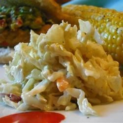 Creamy Coleslaw Recipe - It's the dressing that makes the creamy part--it's made with sour cream, mayonnaise, vinegar, and Dijon mustard.