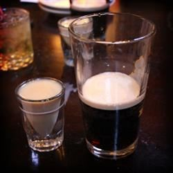 Irish Car Bomb II Recipe - Similar to a boilermaker: you drop a shot glass full of Irish whiskey and Irish cream into a glass of stout beer and drink it all at once.