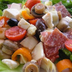 Antipasto Salad II Recipe - Two kinds of salami mix it up with two kinds of cheese, artichoke hearts, olives, tomatoes, and roasted red peppers in this colorful salad.