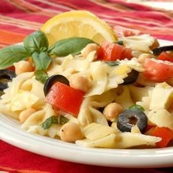 Jim's Birthday Pasta Salad Recipe - A lot of flavor is packed in this pasta salad, which features cherry tomatoes, artichoke hearts, and garbanzo beans tossed with Italian dressing.