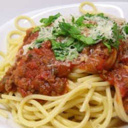 Spaghetti Sauce with Ground Beef Recipe - Rich and meaty spaghetti sauce is surprisingly easy to make, and ready in just over an hour.  Serve over any variety of hot cooked pasta.
