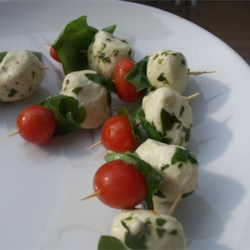 Caprese Appetizer Recipe and Video - Your guests will love these bite-sized skewers of mozzarella cheese, fresh basil, and tomatoes.
