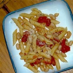 Pasta and Beans Recipe - Simple yet delicious- cannellini beans and penne pasta mixed with chopped onion and fresh tomatoes.