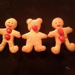 Gingerbread Bears Recipe - These scrumptious little cuties taste great decorated with icing or just left plain.  For a darker, spicier cookie, use molasses instead of corn syrup.