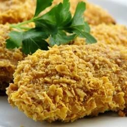 Best Chicken Ever Recipe - Sour cream and corn flakes team up for a tasty twist on ordinary chicken.