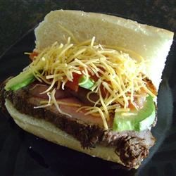 Carne Asada Steak Sandwich with Avocado Salad Recipe - My carne asada steak sandwich with avocado salad recipe is perfect for tailgating.  About ninety percent of this recipe can be prepared in advance - meaning that when game day rolls around, all you'll have to do is fire up the grill, cook the steaks, and melt the cheese on the bread.