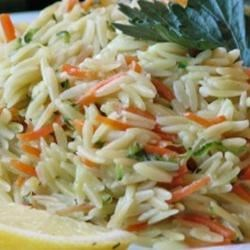 Lemon Orzo Primavera Recipe - Colorful vegetables and the flavors of lemon and thyme make this orzo dish great for picnics. You can chop the zucchini and carrot instead of grating them to cut down on prep time, just be sure to cook them for a few minutes longer before adding the orzo.