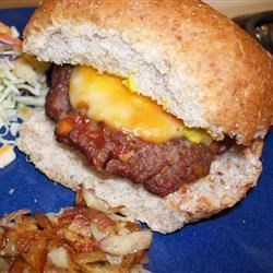 Biggest Bestest Burger Recipe - Basil, Italian-style bread crumbs, Parmesan cheese, and teriyaki sauce flavor these hamburgers for sophisticated palates. They are topped with melted cheese and served on onion rolls.