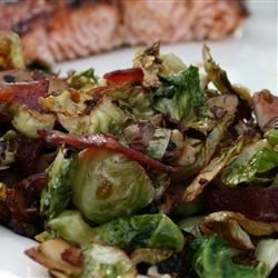 Shaved Brussels Sprouts with Bacon and Almonds Recipe - Brussels Sprouts are shredded like cabbage and quickly sauteed in bacon drippings with garlic and almonds.  This recipe has made Brussels sprouts lovers out of haters.