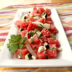 Refreshing Watermelon Salad Recipe - Watermelon, cucumber, and feta cheese are a surprising yet delicious combination of ingredients that make a nice starter salad or light main course.