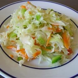 Easy Coleslaw Recipe - This sweet and crunchy salad is easy and delicious any time of the year. Double the recipe for large parties.