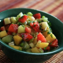 Spicy Strawberry Kiwi Peach Salsa Recipe - This good summertime salsa hits your taste buds with the flavors of fresh peach, kiwi, strawberry, and jalapeno pepper.