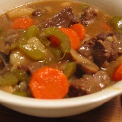 Hearty Beef Stew Recipe - Beef stew meat is combined in a slow cooker with paprika, teriyaki sauce, onion, carrots, celery, potatoes and mushrooms in this thick stew.