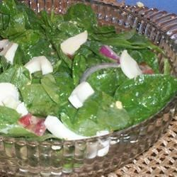 Spinach Salad II Recipe - This salad uses a simple oil and lemon juice dressing with just a pinch of garlic, which allows all the flavors of the spinach, bacon, and cooked eggs to shine.