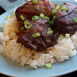 Slow Cooker Moscow Chicken Recipe - Chicken thighs turn tender and delicious when wrapped in smokey bacon and slow cooked with Russian dressing.