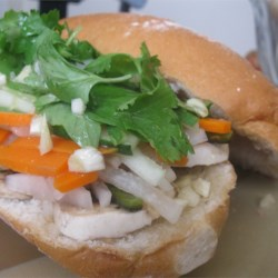Banh-Mi Style Vietnamese Baguette Recipe - These are by far the best sandwiches to serve your guests and yourself!  The ingredients are fresh, delicious, popular and fills your mouth with marinated joy.  You can usually find the high-caloric sandwich (variety of meat on mayonnaise) in your local Vietnamese baguette shop but here is a hearty Vegetarian version (if you do not use fish sauce) using portabello mushrooms.